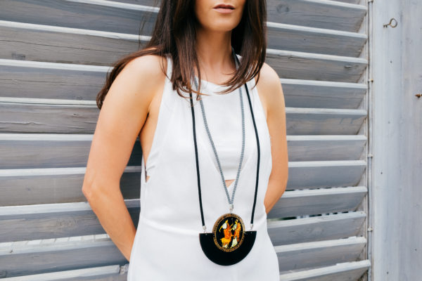 a woman is wearing apollo and artemis