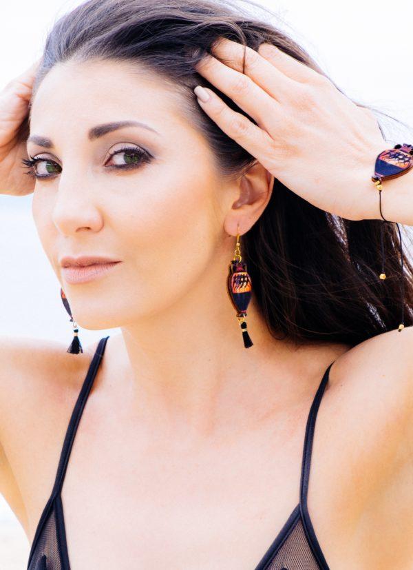 a woman is wearing runners bracelet