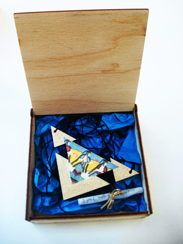 the mycenean triangle necklace in the box