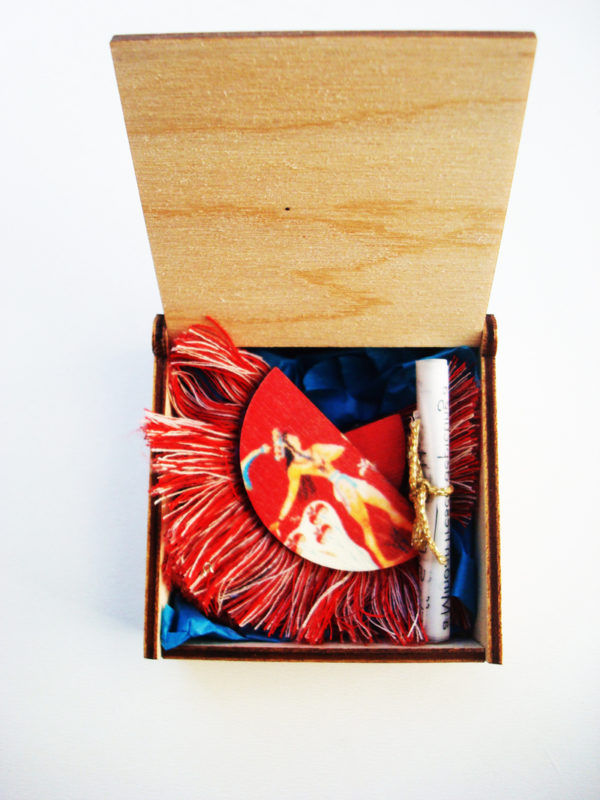 the prince of lilies red earrings in the box